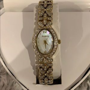 Elgin woman's mother of pearl face gold tone watch
